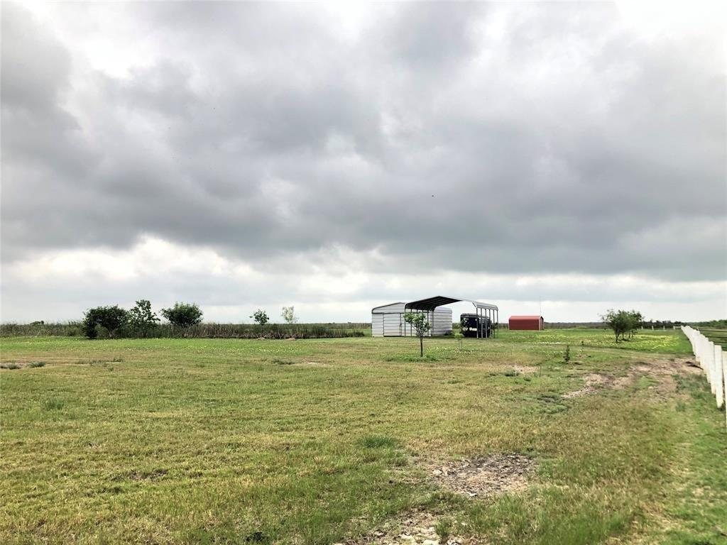 10 Acres is ready for your horses or cattle! Fully fenced with 2 large ponds on the property. Features a large barn, storage building and carport to store all your equipment, a place to let your horses rest and some covered parking. The land is Ag-Expempt & per owners has never flooded!
