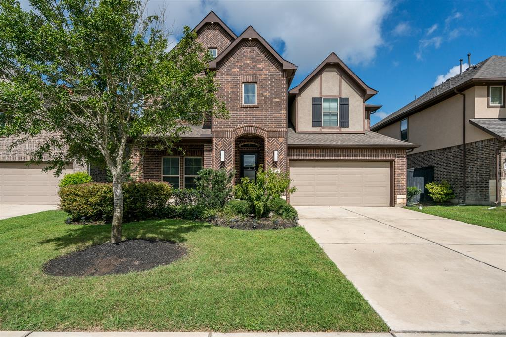 LIKE NEW! Newmark home in Harvest Green. Welcome your guests into a grand entry with beautiful hardwood floors throughout main floor that carry up the grand winding staircase adorned with wrought iron balusters. Open island kitchen with eat-in breakfast area looks out on to the private backyard with no backyard neighbors. Easy entertaining in the heart of the home with gleaming stainless appliances and wood cabinets, large walk in pantry with shelves galore! The formal dining room is right off of the kitchen, ideal for dinner parties, with a dramatic fixture over the dining table. Living room has soaring ceilings and a gas log fireplace. Working from home?  The home office located in the front, providing a private spot to work. Primary bedroom downstairs boasts an ensuite with double sinks, separate bath and shower and HUMONGOUS walk in closet, . 3 bedrooms up, with two in a Jack and Jill formation. Upstairs game room and a large media room (equipment included) with custom barn doors.