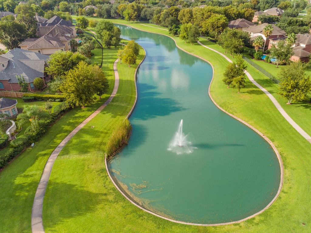 1706 Oak Shade is in the Prestigious Golf Course Community of Greatwood Charleston Estates this home sits on 2 lots on the Lake,5 or 6 Bedrooms,3 Gamerooms,Upstairs Mother-in-Law Suite, Gym, 5 Full Baths and 2 Powder Baths, Safe Room, Storage Pool House w/Full Bath, Complete Outdoor Kitchen,4.5 Car Garage with Rear Entry Very Private,Oversized Automatic Gate,Custom Circle Driveway,Sizable Concrete and 2 Large Grass Areas, Lake Entry for Access to Walking, Stunning Pool and Spa, Custom Stone Privacy Wall surrounded w/ Landscaping.  Kitchen Equipped with all the things you would desire, Large Chef Style with an Oversized Island, 2 Dishwashers, This home is absolutely perfect for Entertaining or Living in Luxury.Laundry/Mud Room 1st Floor.House Features include,Central Vacuum,Sprinkler System,Mosquito System,Landscape Lighting,5 A/C Units,Wood Fence 2020,Handscraped Hardwood Flooring.This sprawling 7804 Square Feet is a perfect use of the space.