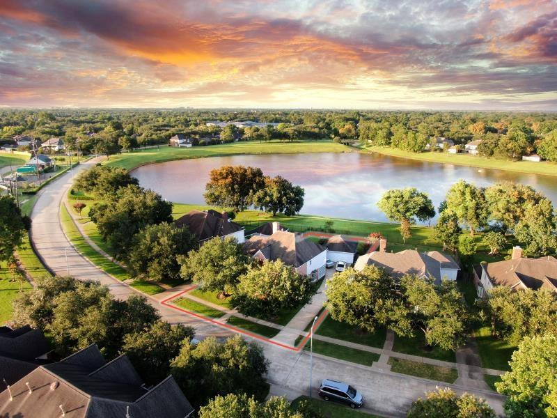 Fabulous 5 Bed 4 bath Lakefront Perry home zoned to the top schools in the heart of Sugar Land. This charming house located in a quiet and serene neighborhood with walking trails outside of its' own backyard. With 2 story entry way invites you to this beautiful & bright home.  Fully remodeled kitchen with top of the line granite counter-top and cabinets, All new appliances includes GE premium oven, dishwasher & microwave. Open concept make it a great house to entertain.  Walls of window in the den & breakfast area allows lots of natural lights into the house. The  primary bedroom with siting area overlooking at the lush trees & the lake. Guest suite downstair is now using as piano room. Huge game room with built in book cabinet & gorgeous view of the lake. Guest suite with private bathroom, Jack & Jill with shared bath. Fresh exterior & interior paint 2020,  2 New Water-heater 2014, AC system updated in 2014 & so much more.  Minutes to school, shopping & Dining. NEVER FLOODED!