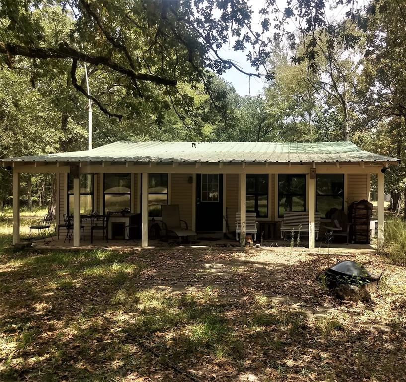 Perfect Weekend Getaway with 1 BR 1 Bth home, large shop, RV shed with hookups, chicken coop and large fenced garden area. Rolling mixed timber with some open, trails throughout. Possible pond site.