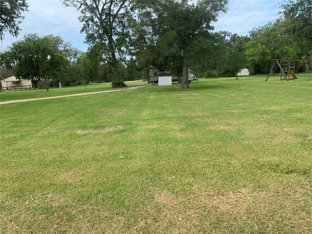 Enjoy all that Wild Peach has to offer and build your very own home on this 5 acre tract. Utilities are already in place: with an aerobic septic, well, and electric. RV hookup is also in place. High & dry this acerage did not flood and is currently zoned 'Flood Zone X'. The property also has a drainage to a ditch located on the back of the property. Survey available upon request. Give us a call with any questions!