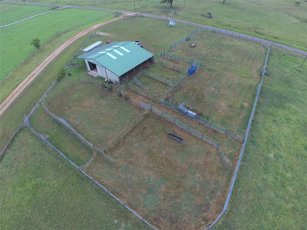 Great Cow/Calf and or BUCKING BULL FACILITY on highly improved 20+or- ACRES. 3000 sq ft metal barn that includes a {1/1} 300 sq ft apartment, tack area, and loafing sheds on two sides. Apt has water heater and septic system. Large working pens, Priefert squeeze chute, BUCKING BULL turn back pen with both left and right hand chutes, and good water well. The ranch is entirely perimeter fenced with mesh wiring, then cross fenced into four separate pastures. Large pond. Paved road frontage! Madisonville ISD.