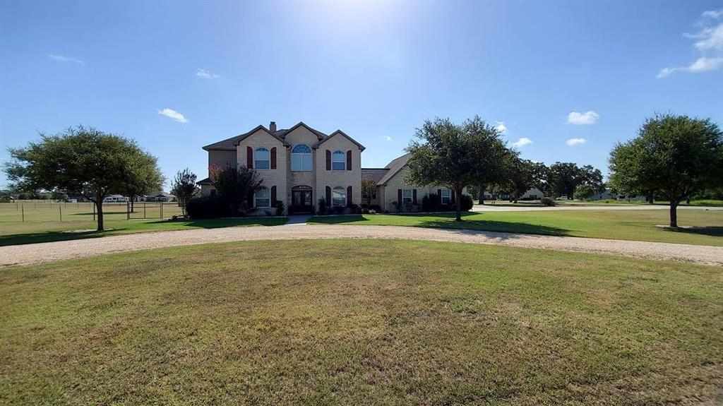 This Gorgeous Home that sits on 2 plus acres just under 3700 Sq ft offers 4 bedroom, 3.5 bath, Located in Hallettsville's most desired country subdivision only 1 mile from town with NO HOA. includes an Open concept kitchen,breakfast nook, and Living room with a floor to ceiling stone fireplace, formal dining, play room/ study, upstairs study and game room with separate stairwell, large utility with lots of counter and cabinet space. New stainless steel appliances in the kitchen. 3 car garage Custom built 100% wood stained cabinets throughout home. Large closets with lots of storage. Large back patio with a nice southern breeze that is shaded from the evening sun that is just Perfect for unwinding after a long days work. Fenced in back yard large enough for FFA/4H livestock projects. 30x 50 metal shop with 2 roll up doors with 20x30 insulated man cave. This home has received many updates in the last couple of years. Gorgeous home in a fabulous neighborhood. This home is waiting for YOU!