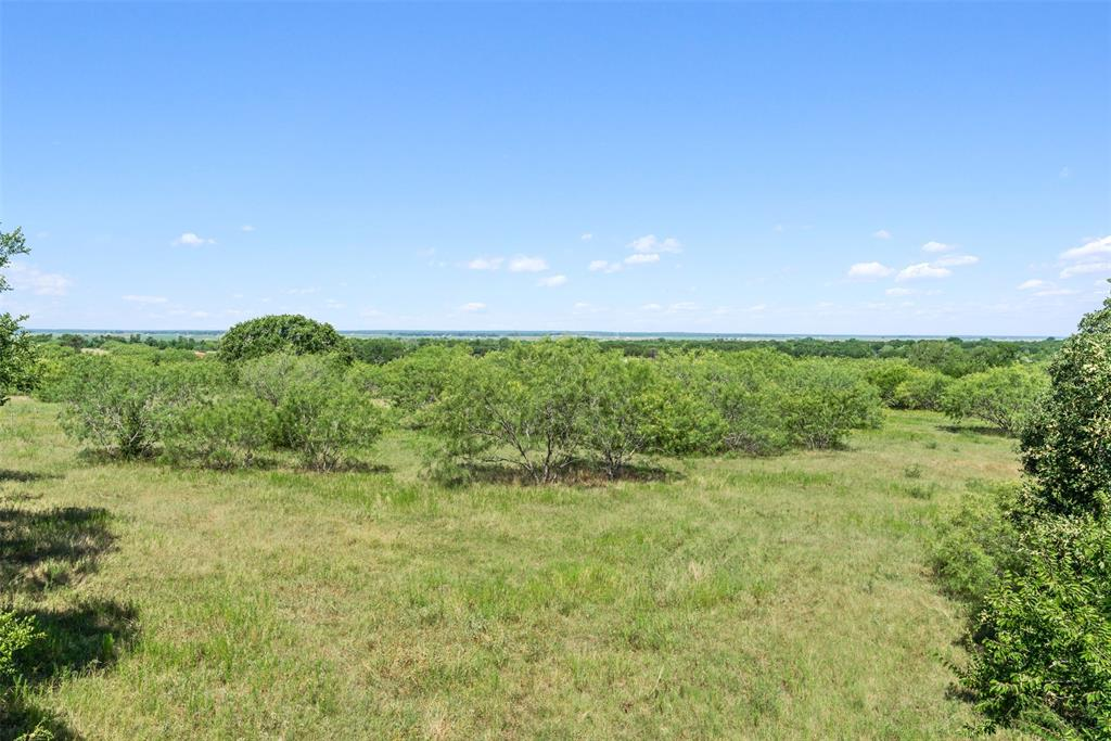 The stunning, panoramic views of this 53 +/- acre slice of heaven must be seen to be appreciated - including views across the Brazos River bottom! With paved road frontage and access to Wellborn Water, this property is perfect to build your custom dream home, a weekend cottage, or for recreational use. This beautiful property is ag-exempt, has perimeter fencing on 3 sides, and a wet weather creek along the Northern boundary. Gorgeous mature trees provide shade in and around the creek offering shelter to numerous woodland creatures. Enjoy the serenity of the country within a short drive to town. This property is located 12.6 miles from Texas A & M University main campus, 4.1 miles from the TAMU RELLIS campus, 4.6 miles from HWY 6 and just 2.1 miles from Lake Bryan.