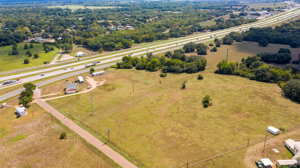 LOCATION, LOCATION, LOCATION!    10 acres out of 11 acres is being sold on HWY 90 (feeder road on Interstate 10) and Alleyton Rd just a few miles from the east side of Columbus. Great location for your commercial business- located right after a west bound exit and near an on-ramp. The property comes with a 1248 sqft standard frame home along with 2 mobile homes, all used for rental income. On location you will find 2 aerobic septic systems and one water well. This is a great opportunity and a great location!