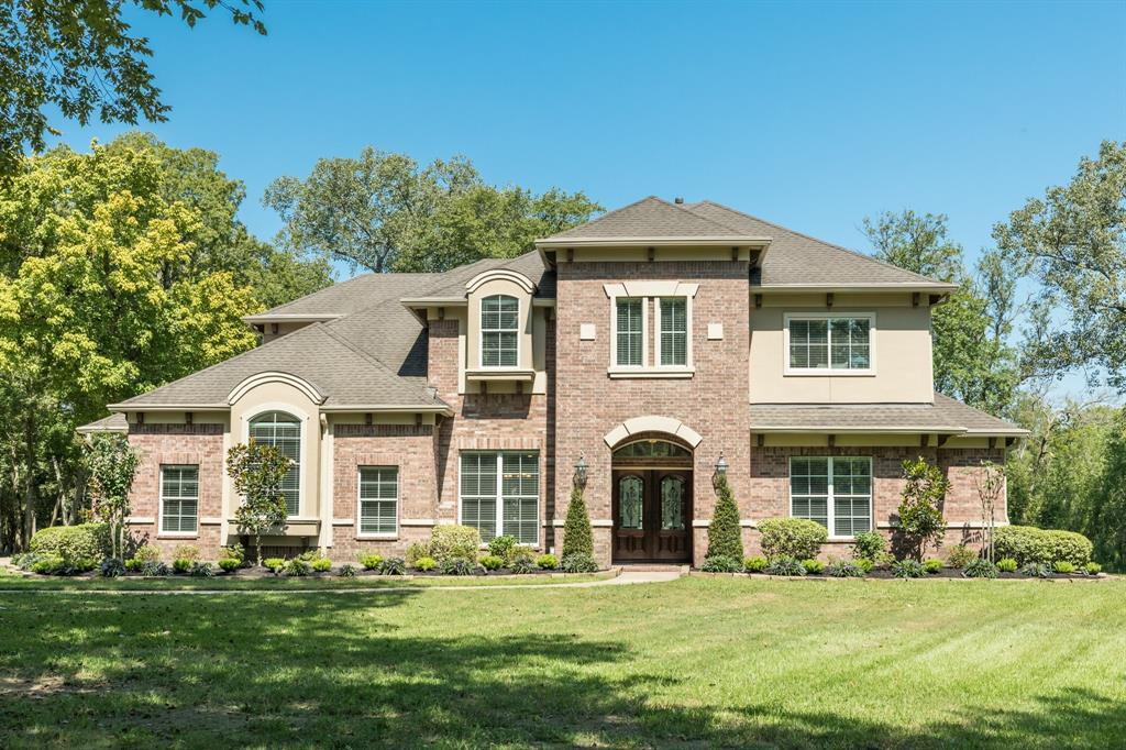 This gorgeous custom 4 or 5 bedroom, 4 and a half bath home built by Partners In Building on a 5.859 acre wooded lot at the end of a cul-de-sac is the epitome of Sienna Point living!  Home features a study, formal dining room, island kitchen, game room, media room which could be a 5th bedroom and a 4-car attached garage.  Primary bedroom down along with the guest room which has a private bathroom. Beautiful real wood floors extend through the downstairs common areas and up the stairs. Built-in cabinets with lighting flank the fire place.  Spacious kitchen with granite counters, custom cabinetry with under-cabinet and above cabinet lighting.  Central vacuum system for easy cleaning. Upstairs there are two bedrooms connect by a bathroom with two sinks and a separate water closet. Recent updates include irrigation system, exterior and interior painting, landscaping, refinished front door, silicone expansion joints in concrete and more!  Do not miss this impeccably maintained home!