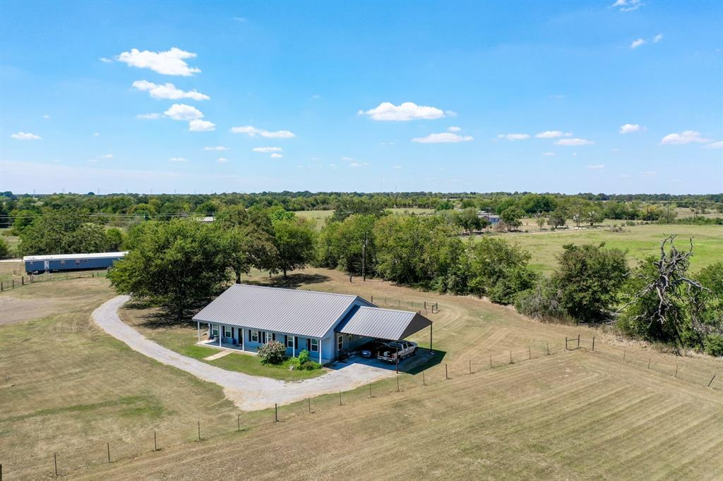 You will feel right at home at the Gasen Farm in Madison County.  This beautiful horse property offers an immaculate Hardiplank home that sits on 11.06 +/- acres.  The home has a split plan with 3 bedrooms, 2 full baths, open concept living/kitchen/dining areas, granite counter tops, kitchen island, pantry, bonus room, and sun porch.  Amenities include a 40x60 barn with tack/feed room and 8' and 12' overhangs, 5 - 12x12 horse stalls with an enclosed 32' run; Priefert panel turnout pen, dog fence, pastures are perimeter and crossed fenced, and there is a small pond.  This well maintained tract of land is approximately 95% open and is ready for your horses or other choice livestock.   Conveniently located just outside of Bryan/College Station with ease of access to Highway 21, this horse property is a must see.