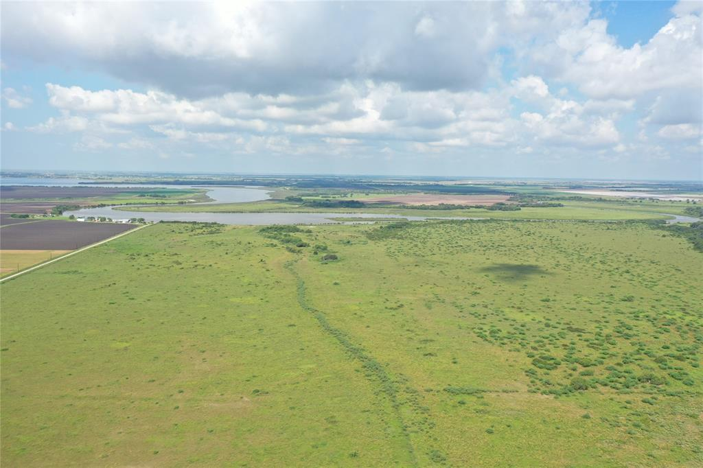 132.35 Acres in Matagorda County, located just South of Tin Top on the East Bank of the Tres Palacios River. If you are looking for a home site in the country with a spectacular view, this is it! The sunsets over the river are fabulous and enhanced by the elevation. Fishing is great right on the property or a short boat ride allows direct access to Tres Palacios Bay and into Matagorda Bay. If hunting dove, quail, deer and hog are high on your list, look no further. As a bonus, some minerals convey with the purchase. The pasture has a cattle lease and Ag Exempt.
