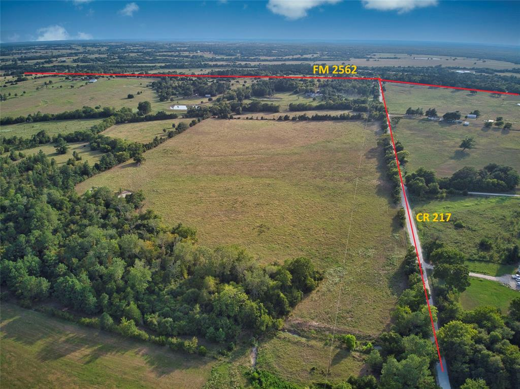 48.56 acres UNRESTRICTED acres ready for you to build a home, barn, workshop, business, or all of the above. Great land for farm and ranch or hunting. Small pond and portable building on the property. Completely fenced.  Anderson-Shiro ISD. Low tax rate. 1.5 hours to Houston, 2.5 hours to Dallas, 30 mins to Huntsville and 30 mins to College Station. Great place to get away but still close to major cities.