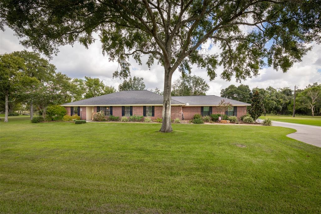 Welcome to your dream home located on two lots. Enjoy the ride to the very desirable Bernard Timbers subdivision located just minutes from the lovely town of East Bernard. Take time to admire the professionally landscaped yard before you walk into your new home. Park in the oversized garage or outside in the extra wide driveway & kick your shoes off in the large mud room. There are 2 living areas for cozy family time and guests. The kitchen is fabulous,  bright & roomy with plenty of space to gather. The double oven makes cooking fun & easy! A split floor plan gives you privacy. All bedrooms are generous in size & closets are deep for more storage. The large utility room is off the garage for easy cleanup. The 384 sf detached garage allows for more storage or a workshop. Park your toys in the carport beside the garage. Sit on the back porch & watch deer walk up to your fence. Enjoy a pleasant & safe walk through the neighborhood anytime. This won't last long! (two tax ID's)