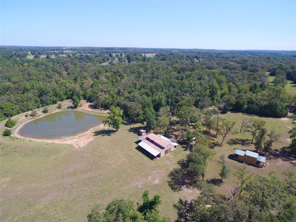 68 acres situated on CR 278 with over 100 ft of elevation change from the front to back of property.  There is a gorgeous homesite that over looks the fertile creek bottom with great views.  There is a nice pond that sits behind the 1800 sq. ft. barn.  Barn has living quarters in it with 3 bedrooms and 2 baths.  A nice screened-in porch that has a woodburning stove for colder months.  There is also a 1 bedroom 1 bath cabin that is completely furnished and has central air/heat.  Property has a 270 ft. deep water well and is completely fenced and is about 70% woods and 30% pasture.