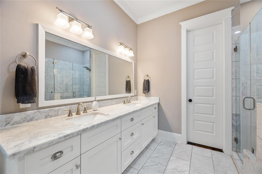 There is plenty of elbow room in this huge master bathroom. The classically finished space includes marble tile floors, a Carerra marble countertop, a huge double sink vanity and a giant vanity mirror.