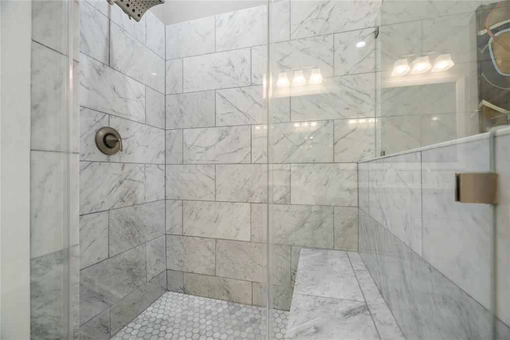 You're also going to enjoy the large separate shower with marble tile surround, hexagon shaped marble floor tile, and a nice sized bench.