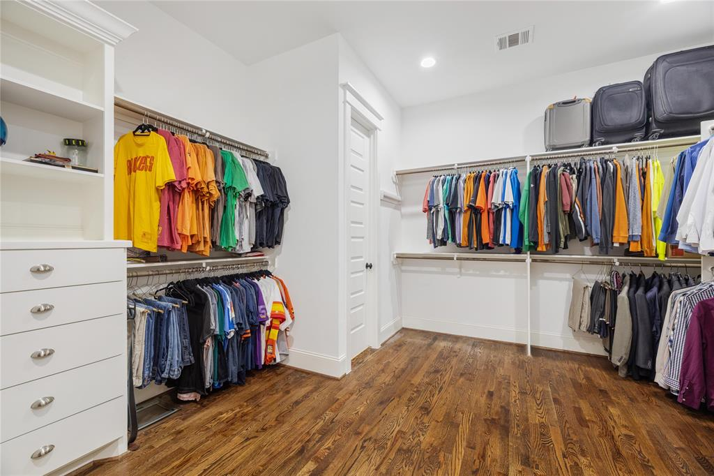This is the master closet of your dreams. This huge space is the size of a small bedroom. It includes hardwood floors and tons of built-ins.
