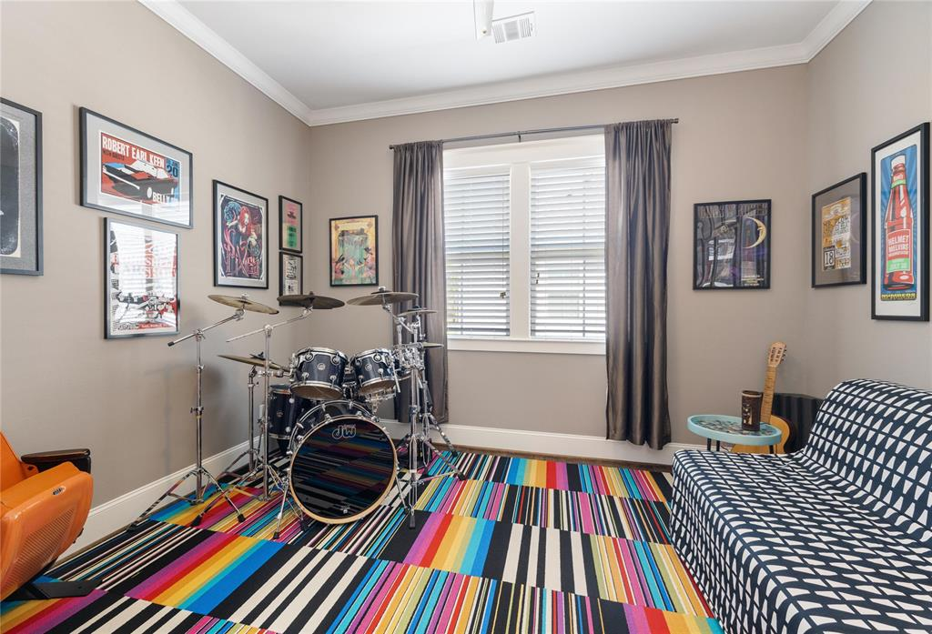 All of the secondary bedrooms include hardwood floors, crown molding, and generous closet space.