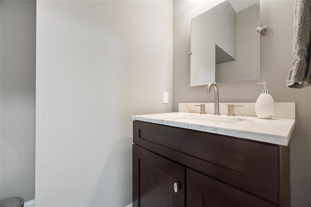 This half bath is conveniently located downstairs off the mudroom space.