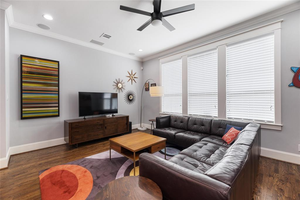 This generous living space is a great place to watch the game or relax in the afternoon. Includes built-in surround sound speakers, recessed lighting, and a remote controlled contemporary ceiling fan.
