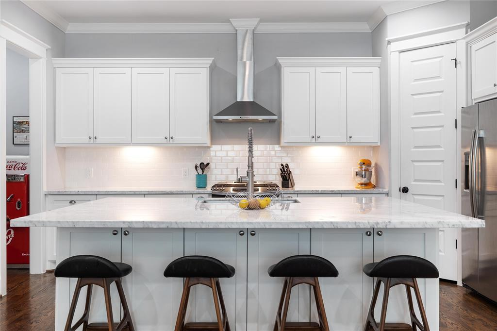 The large center island offers plenty of seating for 4. The chef in your family will love this giant space for prep and service. Per the seller, this space has been a great space to entertain and spend time with family.