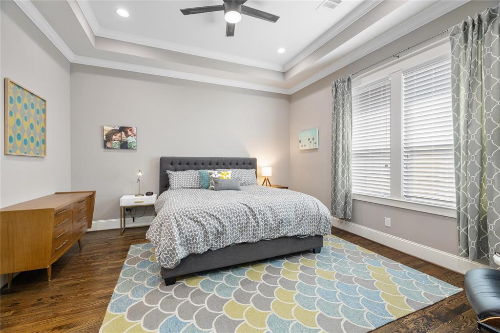 You're going to love ending your day in this gorgeous master suite. This large king size master bedroom includes hardwood floors and a dramatic recessed ceiling.