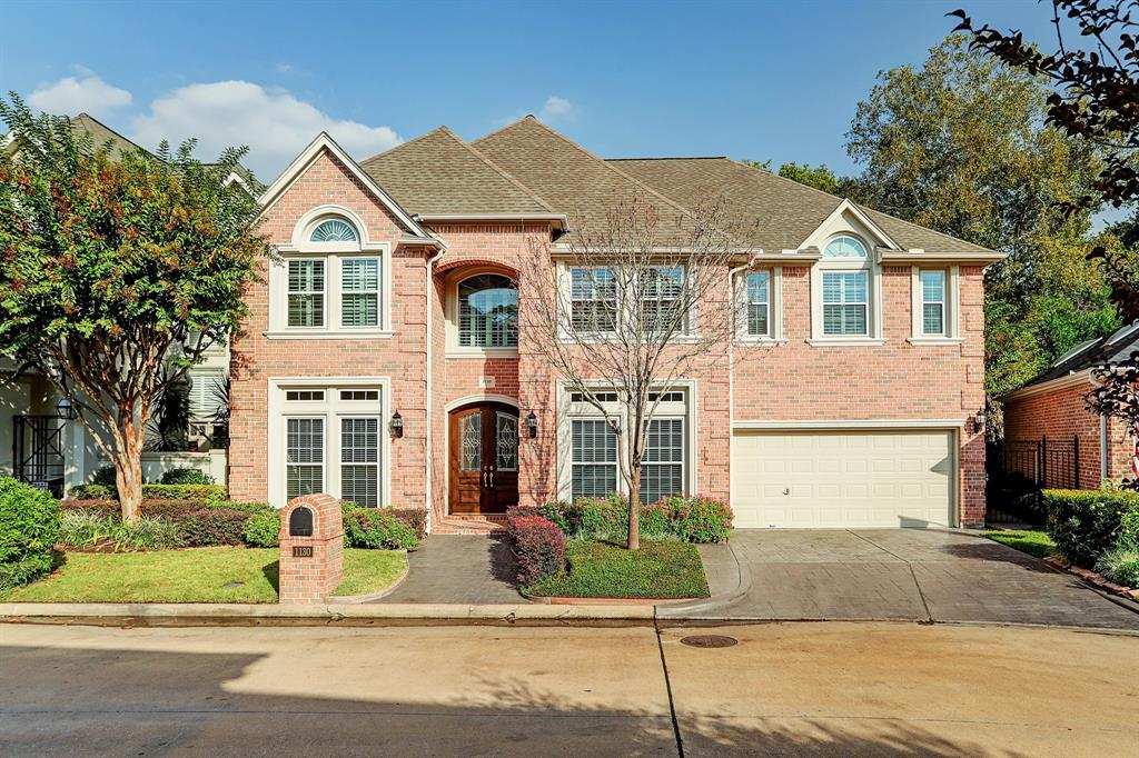Located in the highly sought after gated community of Bayou Island Park, this immaculate 2 story home features five bedrooms, four baths and luxury modern finishes all throughout. You're greeted by an arched grand entrance with an elegant iron staircase. The spacious living area features a wall of large ceiling to floor windows and double door access to the backyard. The stunning chef's kitchen features granite countertops, a large island, and a butler's pantry with a wine cellar. The primary bedroom is located on the second floor and features high ceilings plus a private coffee bar. The backyard offers a vast amount of green space, as well as a covered patio and grill area. And don't forget this home is zoned to Houston's finest SBISD schools: Frostwood elementary, Memorial middle & HS.  Lot size represented in listing includes fully fenced 3,790 sq ft green space.
