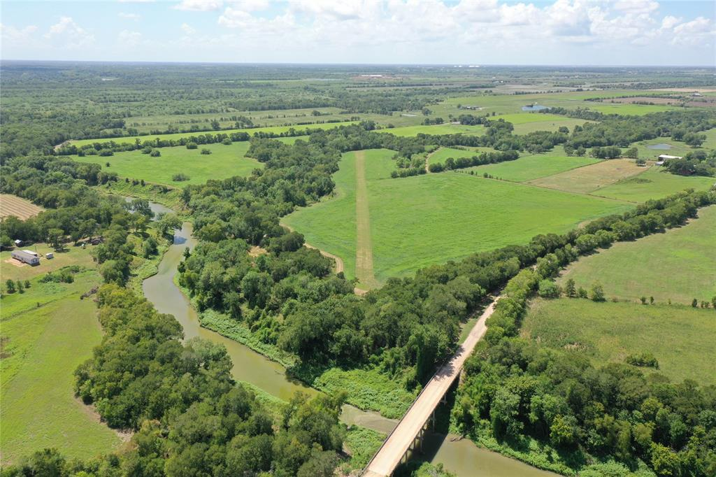This beautiful combination of two tracts totaling 70+/- acres is the perfect place to call home or leisure weekend getaway! With a half mile of Mill Creek frontage and a concrete boat ramp, you will be on the water fishing and relaxing in minutes. Open lush green pastures currently under excellent hay production with ample hardwoods provides the perfect mixture of wide open spaces and coverage for livestock, wildlife and hunting. Campground area offers an escape from the hustle and bustle of town. Ag exempt. Private FAA approved licensed 1,600' air strip. Sandy loam soil, whitetail deer, seasonal duck pond, abundant dove and seasonal creek.