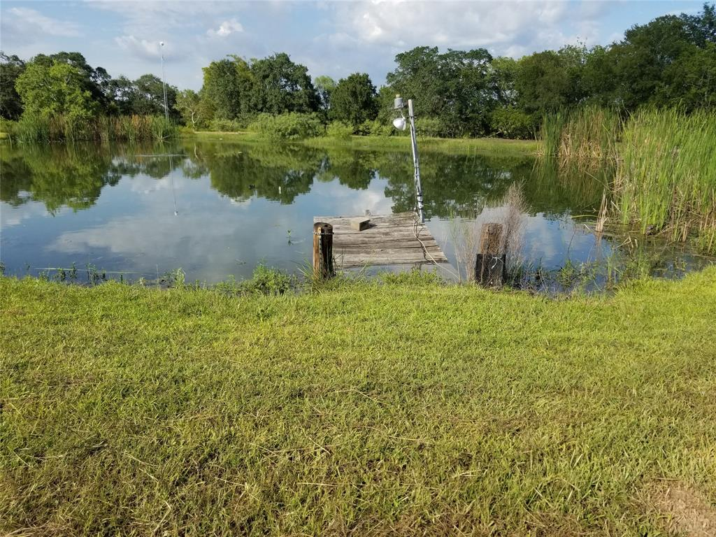 Have you been looking for the perfect place to make all of your dreams come true? Look no further. This beautiful almost 55 acre plot has 2 water wells, 2 power poles and a 1/2 acre fully stocked pond. It also boasts a spacious barn with a studio apartment and a mobile home the seller's will consider leaving for the right offer. It truly is a MUST see!