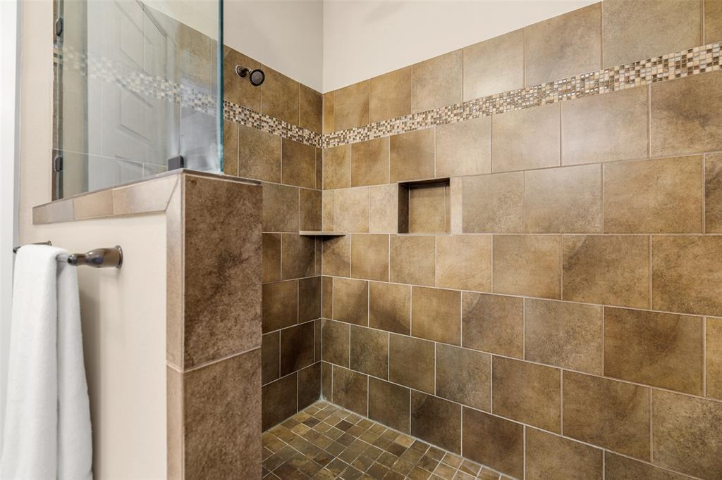 The master bath also features a massive shower with modern finishes.