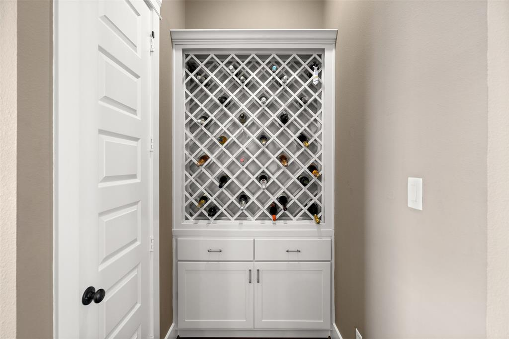The kitchen also features a built-in wine rack with storage.