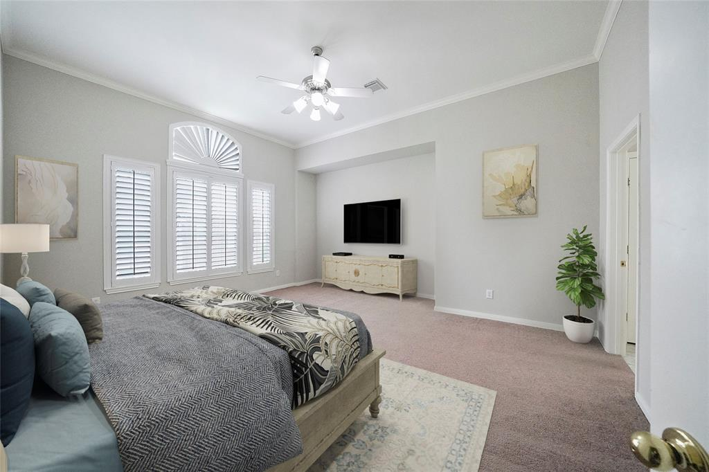 Main Bedroom is spacious and full on natural light with plantation shutters, en suite bath and walk in closet