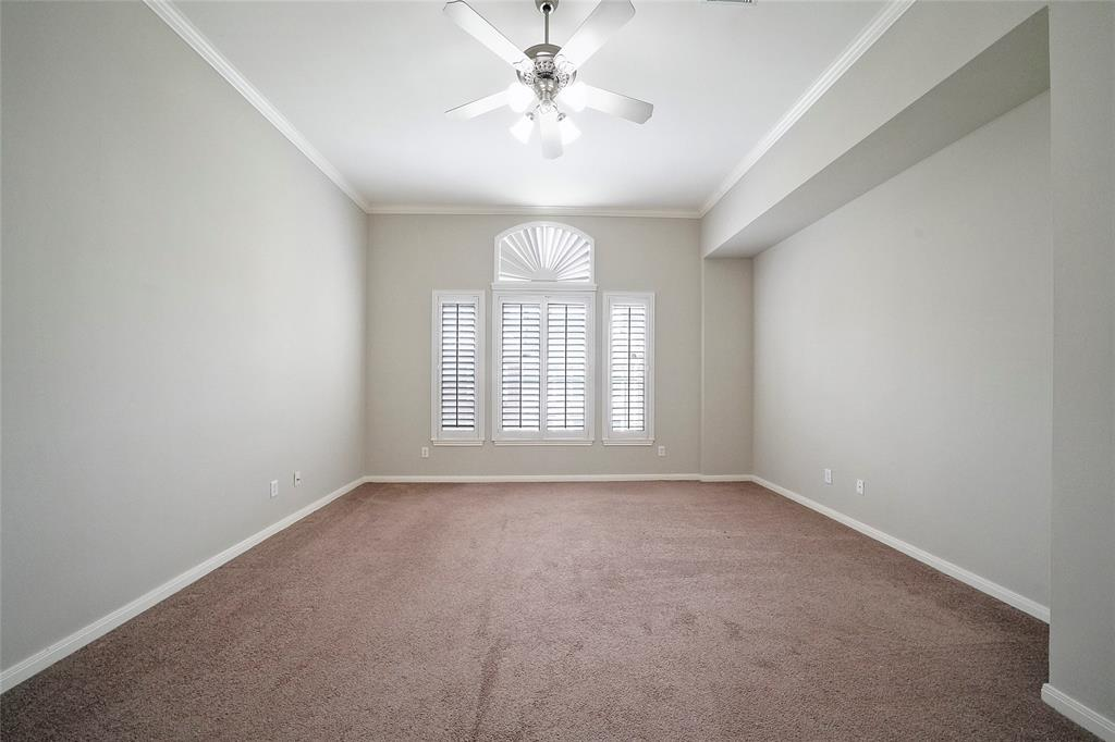 Main bedroom upstairs, carpeted with window treatments. Plenty of space for king bed plus other furniture.