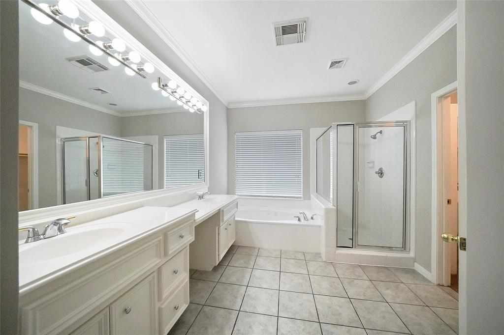 Main bathroom with shower and jacuzzi bath. Dual sinks and walk in closet.