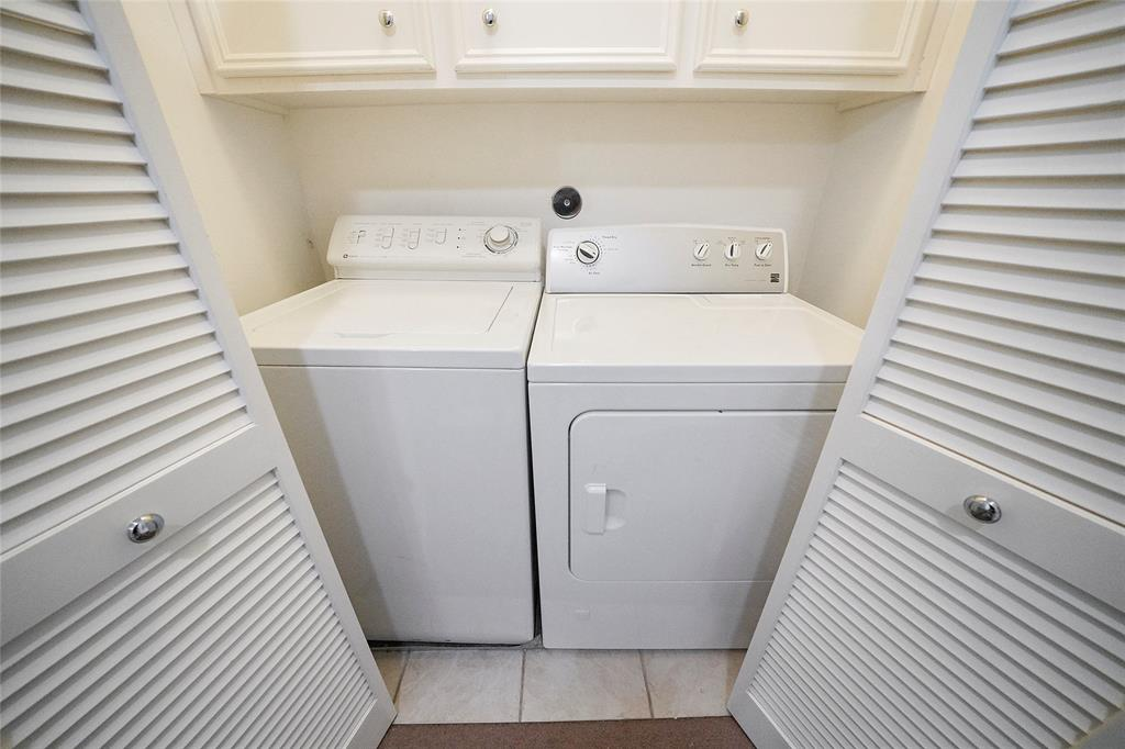 Laundry area in upstairs hallway.
