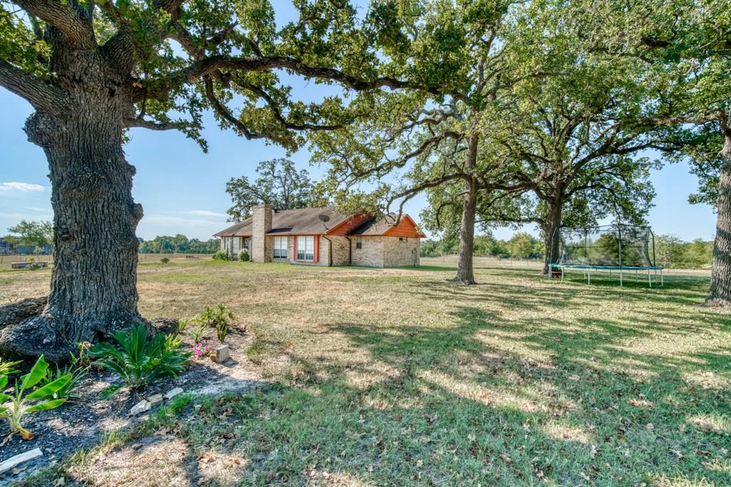 Looking for the perfect spot in the country, this place is it!  Located just 100 miles north of Houston, this 45 acre property is perfect for hunting deer and hogs, fishing with the family, a place to raise a few cattle, perfect for horses, or improved pasture for cutting hay.  The 3 bedroom, 2 bathroom brick home overlooks one of the water sources on the property.  The home has a garden tub in the master bath and double closets, 2 beautiful bay windows, and a fireplace in the den.  There is  also a 40x50 shop on a slab.  Whether you are looking for a weekend getaway or a place to call home, this property certainly has potential.