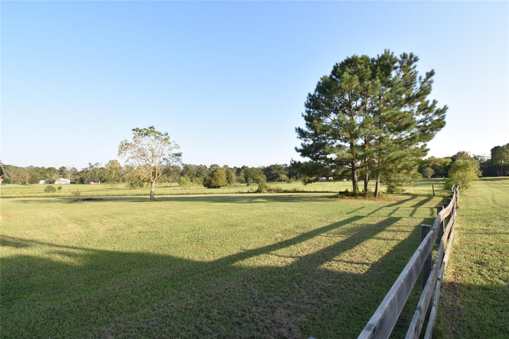 Beautiful 10 Acres of pasture, fenced and crossed fenced.  Workshop, Well, Equipment storage Pavilion and small barn with tack room.  Lake Livingston Water available as a public water service as well.  Fenced and crossed fenced.  Pasture is in great shape.  Cows, horses or other grazing animals.  Ready to go.  Build your home or bring your mobile home and start your new life in the country.