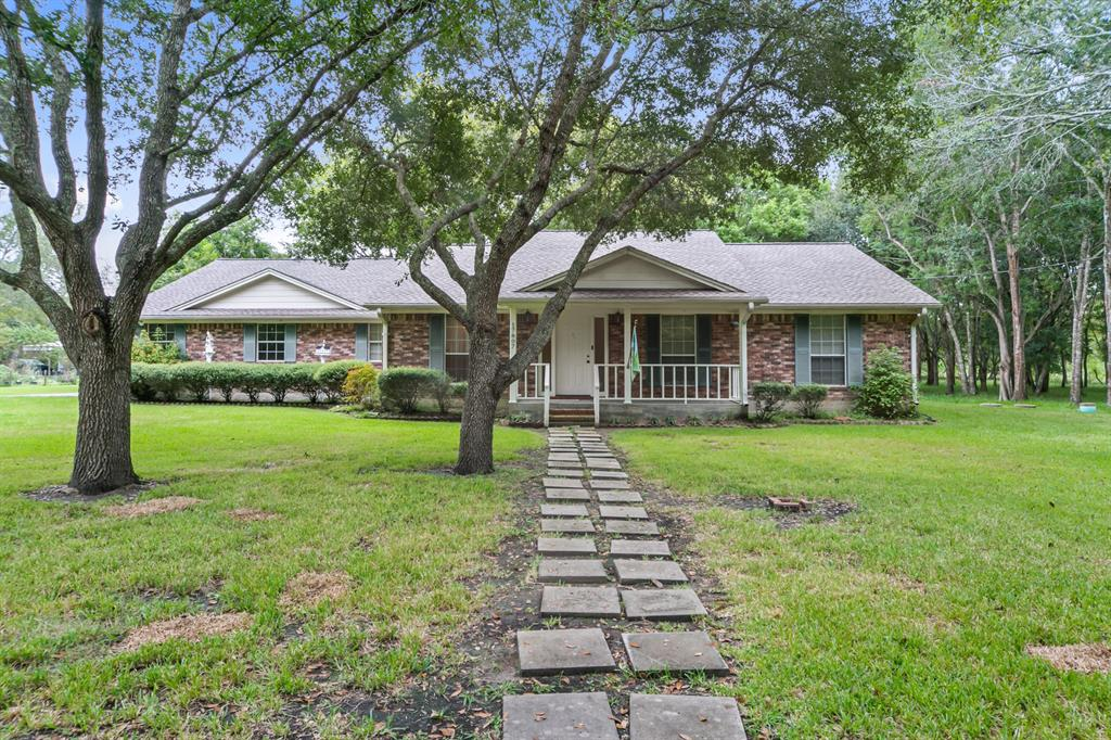 Charming single-story Ranch home on over 5 ACRES with a private pond, on septic, in the highly-acclaimed Pecan Bend community; complete with 3 bedrooms, 2.5 bathrooms & 2-car attached garage. Features include a new roof & hot water heater (2019), water softener, alarm system, crown molding & fantastic natural light throughout. The spacious open floor plan includes a formal dining room, study (or optional 4th bedroom) & spacious family room with french doors opening to a fantastic screened porch. The Chef's kitchen boasts a nearby breakfast area, large pantry, timeless white cabinets & electric cooking; including an electric oven/range & built-in microwave. The Master Suite offers a walk-in closet & en-suite bathroom with a nice standing shower. Secondary bedrooms are bright & spacious with a full bathroom (with an over-sized soaking tub) to share. Pecan Bend offers quiet country living near the benefits of city amenities, backing to Brazos Bend State Park. Zoned to Needville ISD.