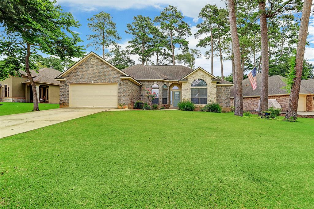 Beautiful one-story home with excellent curb appeal is located on the east shore of Lake Conroe and boasts walking distance to the lake in a GUARD-GATED community! Spacious, open floor plan is flooded w-natural light. Chef's kitchen features gas range, convection oven, abundant cabinetry, & granite countertops that opens to the breakfast nook w-access to the backyard. The oversized living room offers an inviting welcome w-gas log fireplace great for entertaining family & friends. Homeowners' retreat has dual vanities, separate whirlpool tub, shower & walk-in closet. Two other sizable bedrooms split from the master provide maximum privacy. Flexible formal dining can be used as a study & features French doors w-entry from 2 sides. Nice-sized fenced backyard offers covered patio, 12 x 8 storage shed & mature trees that provide shade. Community amenities include tennis courts, 2 swimming pools, marina w-boat ramp access & fishing ponds. Don't miss this gem of a home w-resort-style living!