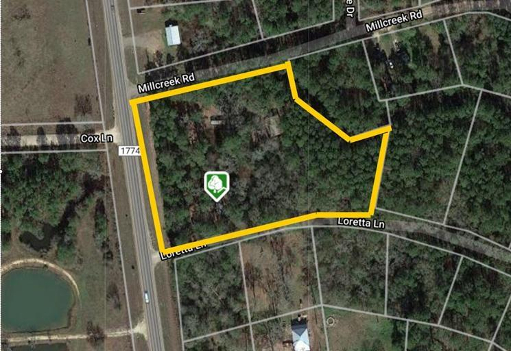 Come see this approximately 2.62 heavily wooded lot featuring a creek running through it. The sale includes 5 parcels which are R27209, R27181, R27208, R27180 and R27207. Located just seven miles north of the City of Magnolia and just north of the Texas Renaissance Festival Fairgrounds. The property has approximately 500 feet of frontage on FM 1774. Improvements include 30x60 (40x60 if you include the covered front porch) dried in central air conditioned building including 1 large living space, 1 bedroom and full bathroom. 2nd building located at rear of the property is 40x30 and has roughed in plumbing for bathroom addition if desired in the future. Both buildings include entry doors and garage entry doors, slab foundations and are approximately 10-15 years old. Property is partially fenced could be used for commercial business or private residence.