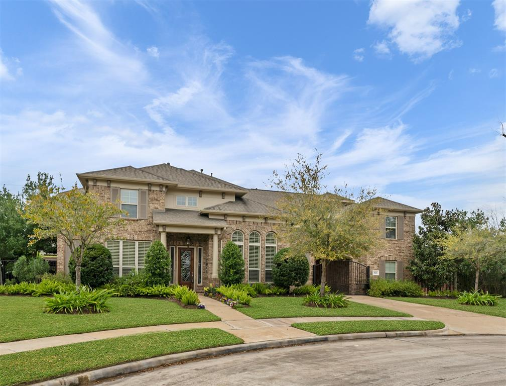 One of a kind stunning David Powers custom home on cul-de-sac lot with saltwater pool and spa features a new roof (July '20), recent paint, wood & tile floors, plantation shutters and custom details throughout. Two-story foyer with wrought iron staircase & art niche opens to study w/French doors & formal dining. Spacious living room has gas log fireplace flanked by custom built-ins, French doors overlooking pool & opens to gourmet island kitchen w/breakfast bar, custom cabinets w/lighting, granite counters & S/S appliances. Master suite w/sitting area has linear gas fireplace w/custom built-ins & master bath touts quartz counters, dual vessel sinks, whirlpool tub & separate shower w/seating. Game & media rooms up w/temperature controlled storage rooms, study nook & secondary bedrooms with two full baths. Spectacular oasis style backyard has pool w/rock waterfall surrounded by flagstone decking, pergola, outdoor kitchen, remote control patio awnings & private guest suite w/full bath.
