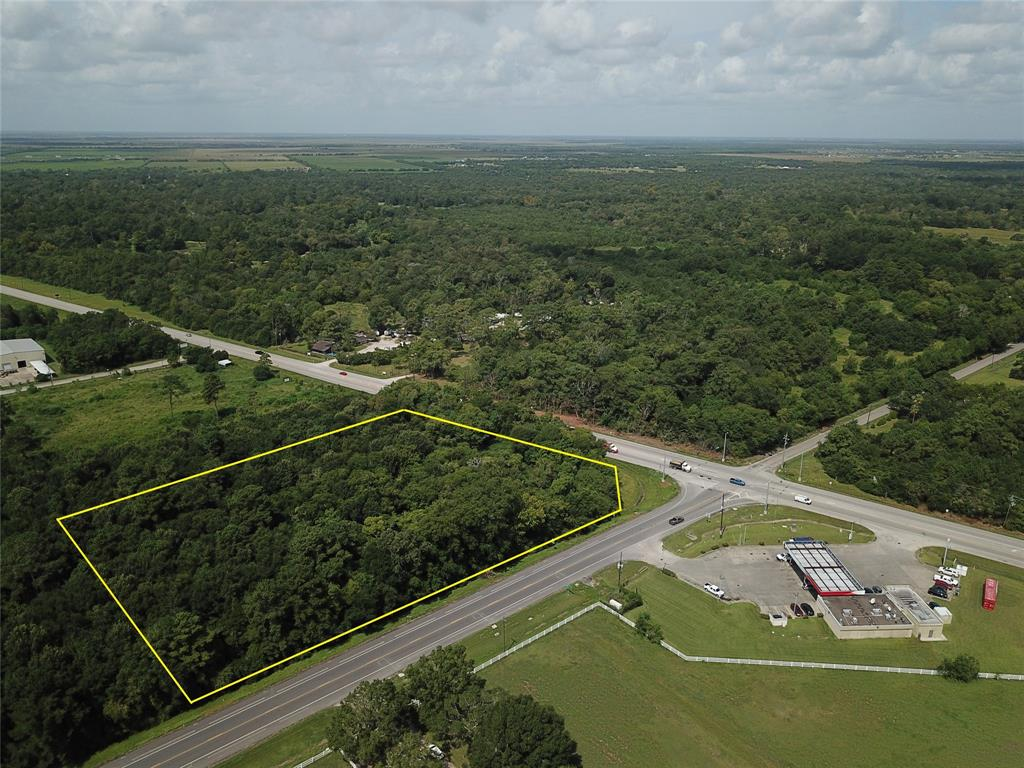 This tract will be impacted by the Grand Parkway (SH 99). The current plans show that portion of the site along the SH 35 frontage as being within the proposed alignment. If and when the the Parkway is constructed, this site should be situated at hard corner of SH 99 and FM 2917. There is no proposed date for construction to begin. Property is vacant and heavily wooded.