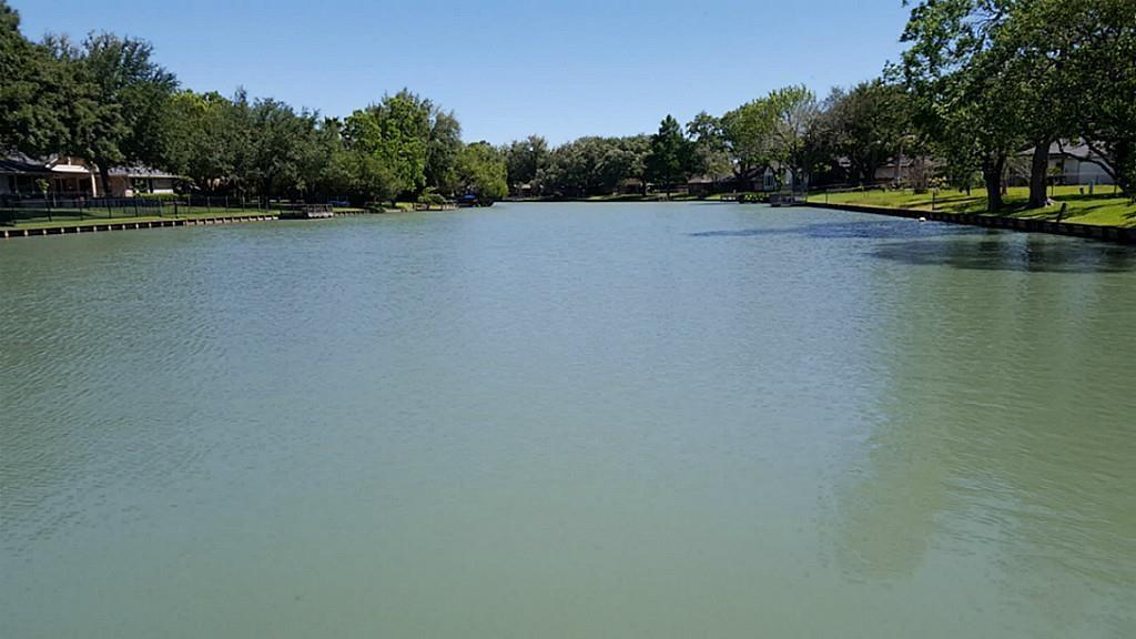 Gorgeous 1/2-acre tree-shaded lot with long view down Lake Venice!
