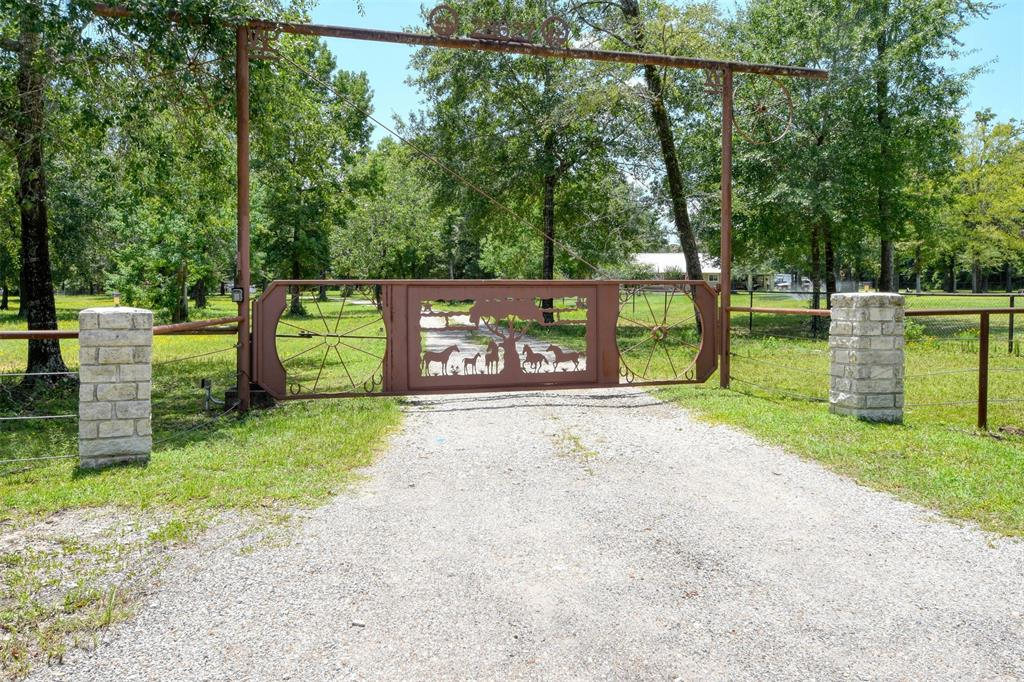 The BEST of both worlds: peaceful country living on acreage with proximity to all amenities & access to highways. A horse lovers/ car collectors dream. Beautiful custom built home on 7.08 acres of wooded land. Entire perimeter of property & the area around the house is fenced with drill stem pipe. Spacious 4 car garage with covered walkway. Ladies, feast your eyes on a master closet that is as big as a bedroom. Over 11'x11' laundry room & a bonus room that could be a SPA as it was intended.Unconventional, very efficient heating system powered by hot water. Working fireplace using either gas or logs can be admired from the formal dinning room or living room. If you love cooking, you'll love the spacious kitchen, Sub Zero refrigerator included, secondary oven, stand alone ice-maker & 2 large pantries. Energy efficient double pane windows. Attic large enough for a future addition. 5 horses, 42'x40' stables with 12' wingspan on each side. Additional 2 sheds. No H.O.A. fees. Don't miss out.