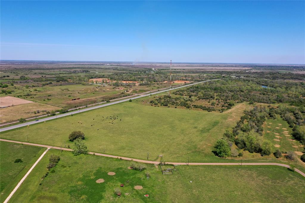 """Situated in Eagle Lake, TX, this beautiful 12.67 acre tract is conveniently located on HWY 90 ALT. It has many added improvements and features so that you don't have to deal with the hassle of permits, approvals, and licensing with the county. This property has both trees and open land, perfect for hunting, cattle grazing, or building a home on the elevation certificate site! Improvements & features include:1) Low Agricultural Exempt Taxes 2) Electricity Meter Installed 3) Certified Safe Water Well 4) soon to be partially fenced 5) Elevation Certificate Site 6) Minimal Deed Restrictions 7) Flat Land   Eagle Lake has earned the title of """"Goose Hunting Capital of the World"""" in the winter season. Many other species of fowl also habitat in the area during the winter time because of the rice fields and the large private lake. Eagle Lake is truly a nature lovers paradise with the wildlife that make's this place their home."""