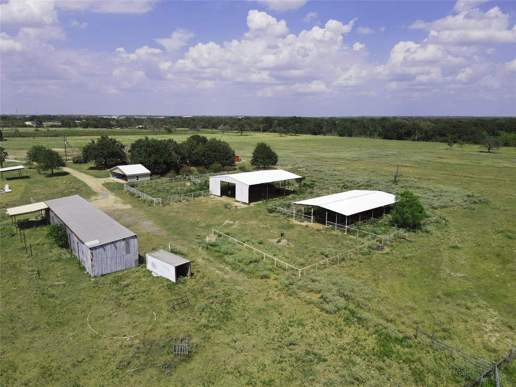 30 acres fronting FM 1227 with approx. 660 feet. This features improved sandy loam pastures. fenced and cross fenced. There will be a new entrance with rock driveway installed.There is a 3,000 Sq. Ft Hay barn, 3,000 SQ FT Bull Barn with 10 pens, approx. 2,000 Sq. Ft equipment barn.  This is a great property for anyone wanting to raise horses, cattle or other livestock. Part of the property is in the flood plain. It will be important to confirm the new flood elevation certificate before building. This will avoid mandatory flood insurance.Power is readily available. Will need a new water well and septic