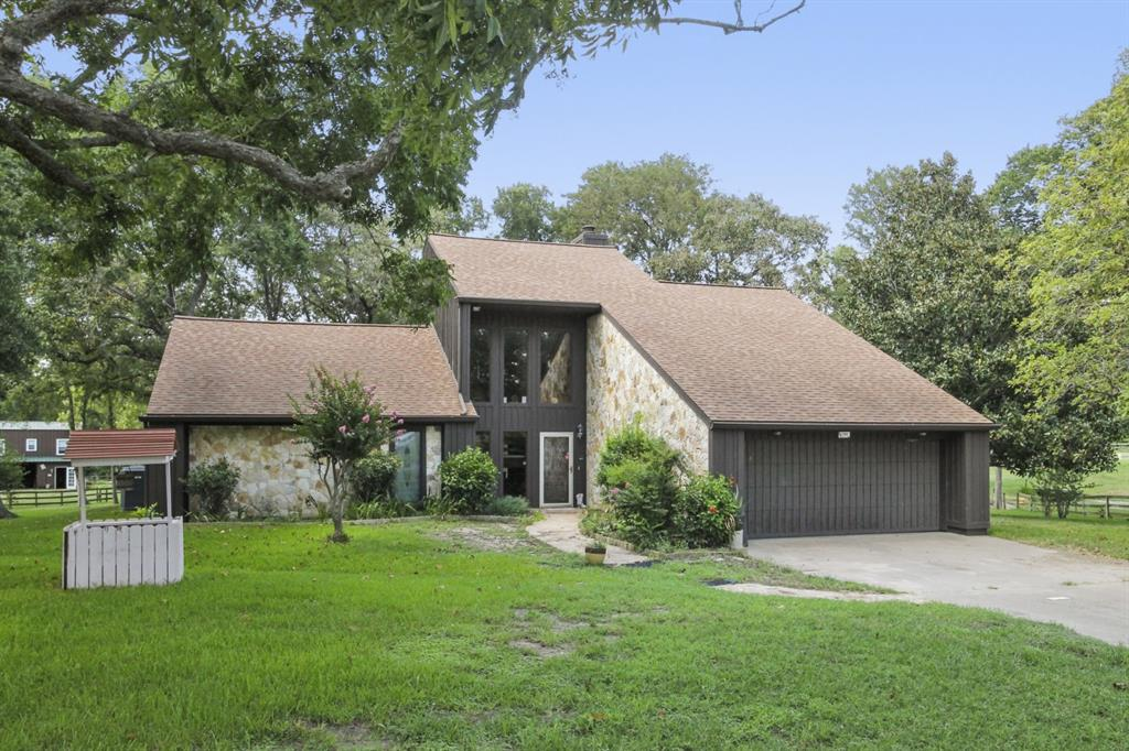 One of a kind Country home on 4.271 scenic, rolling wooded acres, 3 fish ponds, garden 6 miles from Amazon, Costco, 15 mi to hospitals, 40 mi to Downtown. Den has fireplace, glass bookshelves, extra lighting, & windows/doors opening unto Deck's Picturesque views. Kitchen/Dining/SUN Room with cathedral ceiling & lighting accenting the Cypress & Stone walls.  Kitchen has Oak Cabinets, Silestone counters with pull-out table, Insinkerator, Stainless Steel Dbl Sink, quiet Bosch Dishwasher, GE Electric Range/Vent-a-Hood. Several Dbl-pane windows to enjoy daybreak, birdwatching, sunsets, etc. Spacious master bedroom with Jacuzzi tub, dbl-pane glass doors to Spa Area, Full Bathroom, walk in closet. Upstairs two bedrooms/bath & balcony w/more great views.         Barn/Workshop with AC, half bath/ Full Apartment above two Horse Stalls & Storage Shed.  Barn has animal stall & Tractor shed.  Catfish Stocked Top Pond selectively irrigates Garden. Deep well with irrigation pipes .