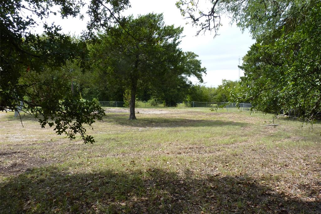 Ideal small acreage that is ready for your new home or weekend getaway close to Lake Somerville. Water well and electric are onsite and near several building sites. Partially fenced corner lot has a gravel driveway in place and large trees for privacy and shade.