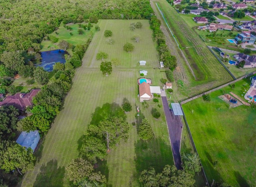 Country Living in the City!  STOP THE CAR! NO HOA, NO MUD TAXES, NEVER FLOODED, NO RESTRICTIONS!    The options are endless, not only does this gem sit on over 6 acres of beautiful cleared land right off of Cullen and McHard it also offers an oval semi above ground pool surrounded by a large composite deck, an outdoor shower, a tall 40X16ft RV/Motorhome carport with 50 AMP service, full hookups, two 16x16 metal storage barns with concrete flooring to store your toys/equipment.  Beautiful fruit and pecan trees welcome you down the asphalt driveway. The home includes custom cabinets, granite counter tops, open living/kitchen floor plan an updated full bathroom with an oversized rainforest shower- 8 shower heads and a wand, tile throughout with carpet in the bedrooms, the primary bedroom has a 12X12 closet with plenty of storage all located on the 1st floor, the exterior includes a 2 car attached carport and a sundeck to watch the sunset. must see, this property shows pride in ownership.
