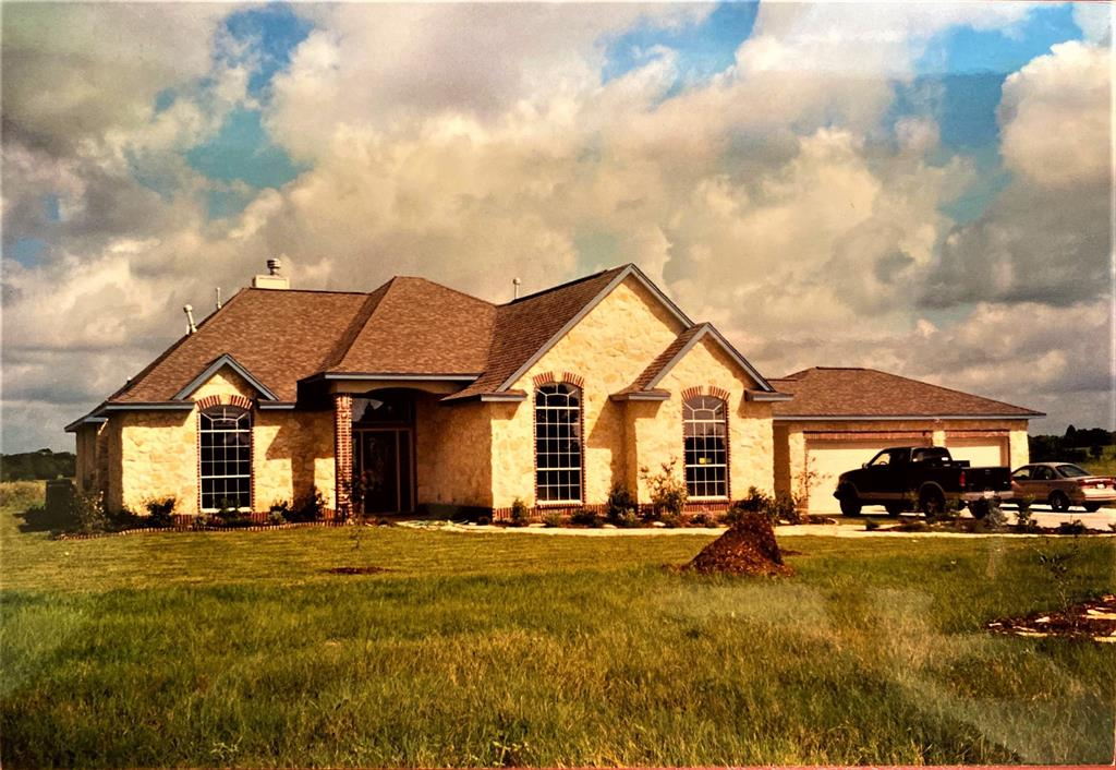 GREAT LOCATION!!!!!! Just minutes from Bellville and Sealy!! Custom built home that sits on 11 beautiful acres. This home features 3 bedrooms and 2.5 baths, with a large study. The formal dining room boasts gorgeous custom columns. The large kitchen has all the storage you will need for entertaining and looks over the immense living area. The master suite is of grand size with large walk-in closet and jacuzzi tub for relaxing. The property boasts large beautiful oak trees in the front yard and also has fruit trees as well in the back yard. Plenty of irrigation on the property, as the owner had a very large garden before. Call today to make an appointment for your private showing.