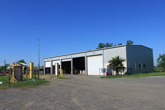 10 acres with all improvements offers a home and multiple storage buildings. The main shop is approx. 5,600 SF 40 x 120, part 2 story, three phase power, and includes a 1600 SF office space/apt. There is a truck scale, stabilized drives, and parking area. The home is 1715 SF 3 bed 1.5 baths. Perfect for a large trucking company, wrecking yard, construction company, etc.