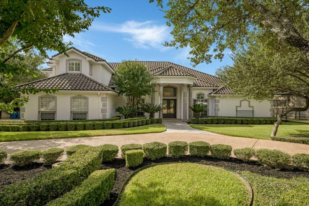 Dramatic Curb Appeal on this lushly landscaped, tree studded .80acre lot in Shavano Creek! Lee Crystal custom home with light, bright neutral interiors features a multi-generational floor plan.Formal living, dining as you enter flows into the family, kitchen and breakfast area. Private owner retreat has spa bath, his/her sinks, closets plus a private study. Upstairs, two bedrooms or bedroom/game room plus an additional bath. Separate downstairs wing has two bedrooms, living, study, kitchen and opens to the central covered patio area. Large stone patio overlooks the treed backyard with basketball court area. Three car side entry garage. Original Owner- this Home has been impeccably cared for with many upgrades and updates.